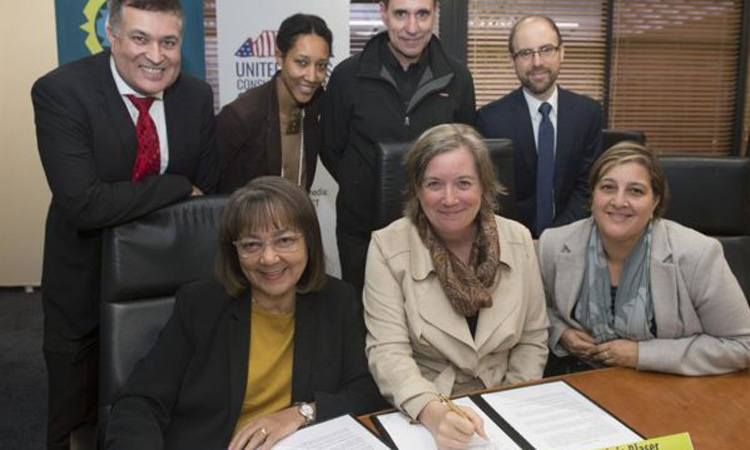 U.S. Consul General Virginia Blaser, Executive Mayor Patricia De Lille, and representatives from the U.S. Consulate and City of Cape Town gather for the signing of the agreement