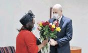 DR Lebo Matlebyane receive roses from the Chargé d'affaires at the US Embassy in Pretoria, Todd Haskell, in remembrance of her husband, Martin Matlebyane.