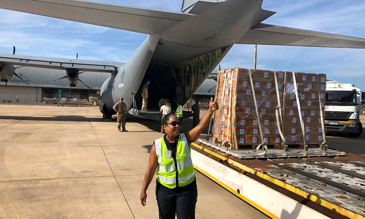 Sherry Zalika Sykes, the U.S. Consulate General to Durban South Africa, right, watches food aid being loaded into the back of C-130J Hercules assigned to the 75th Expeditionary Airlift Squadron, Combined Joint Task Force-Horn of Africa, in Durban, South Africa, March 29, 2019.