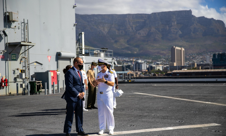 Commanding Officer, Capt. Michael Concannon and Acting U.S. Consul General in Cape Town, Will Stevens, on the vast deck of the USS Hershel 'Woody' Williams