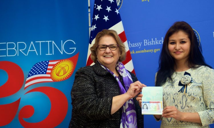 Ambassador Sheila Gwaltney Presents First U.S. Immigrant Visa in Bishkek