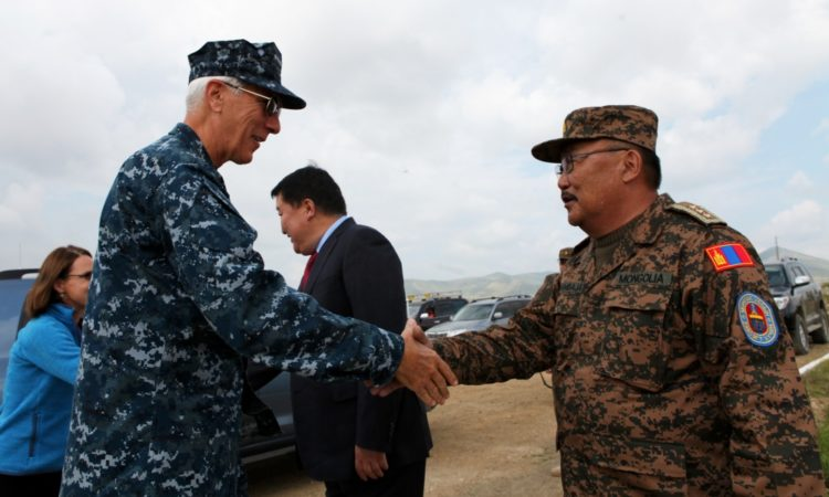 Lt. Gen. Ts. Byambajav (right), Chief of General Staff, Mongolian Armed Forces, greets Adm. Samuel Locklear, commander of U.S. Pacific Command, at Five Hills Training Area prior to the Khaan Quest 2013 opening ceremony, Aug 3.