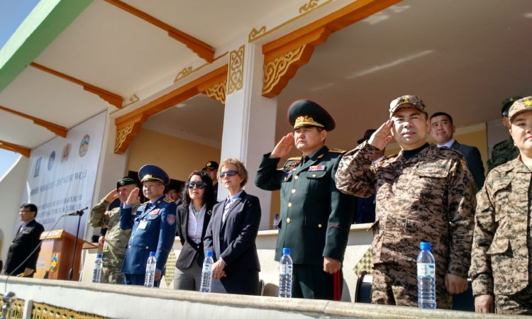 Military officials and Ambassador stand together