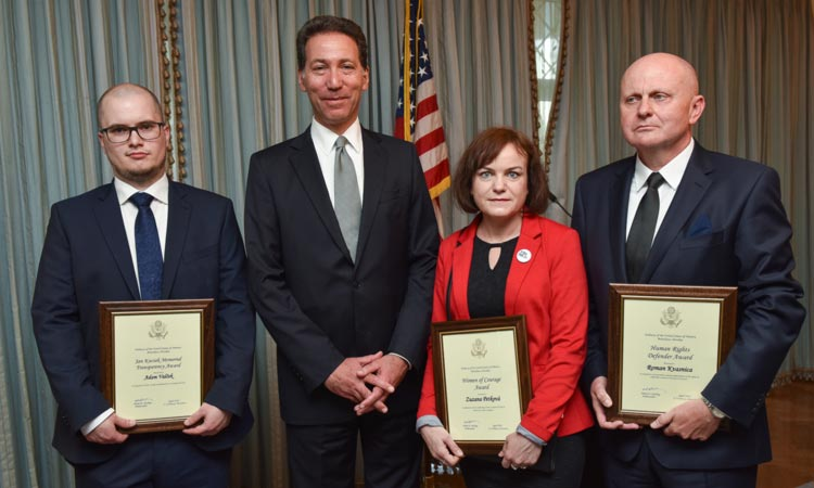 Ambassador Adam Sterling awarding Adam Valcek, Zuzana Petkova and Roman Kvasnica at the Human rights awards ceremony (Embassy photo)