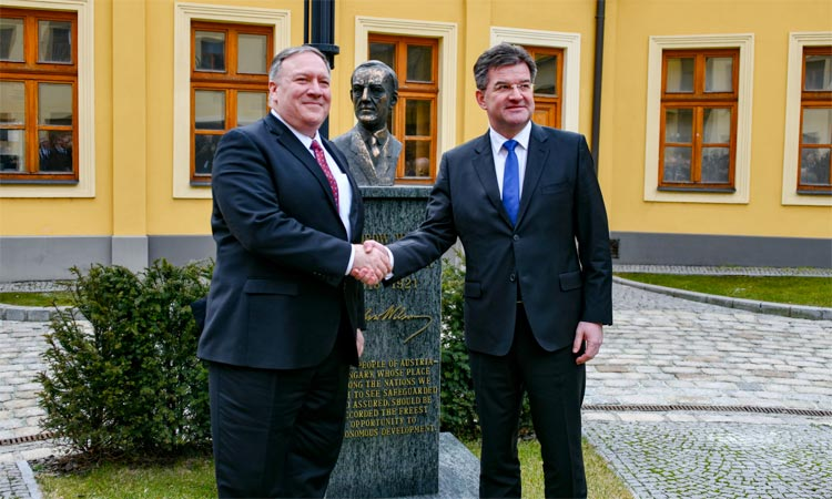 U.S. Secretary of State Michael R. Pompeo and Slovak Foreign Minister Miroslav Lajcak pose for a photo in front of the bust of President Woodrow Wilson in Bratislava, Slovakia, on February 12, 2019. [State Department photo by Ron Przysucha/ Public Domain]