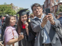 Man taking selfie with two women