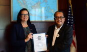 Borneo Bulletin journalist Norazlan Othman receiving his IVLP certificate from Chargé d'Affaires Emily Fleckner at the U.S. Embassy