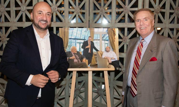 Two men standing. (Embassy Image)