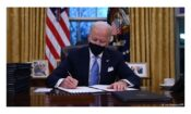 Man signing document. (WH)