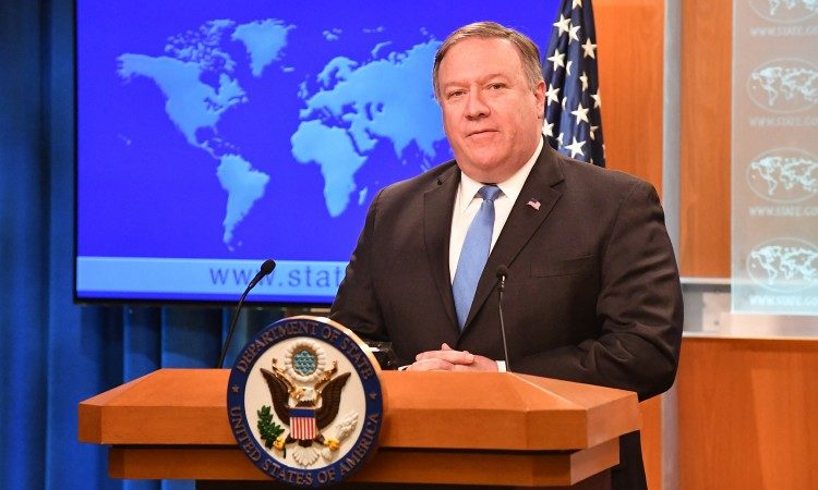 Man standing at podium. (State Dept.)