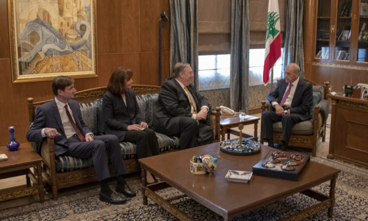 meeting with four people and Lebanese flag