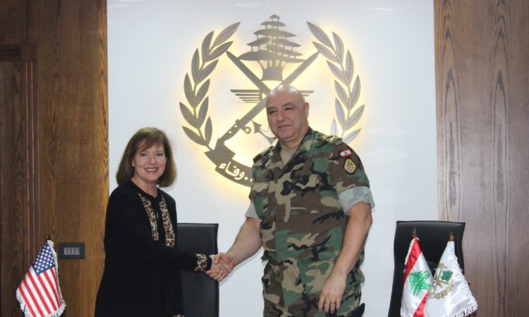 woman and military man shaking hands