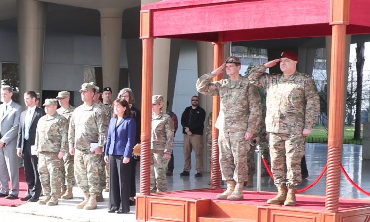 Two soldiers saluting and crowd