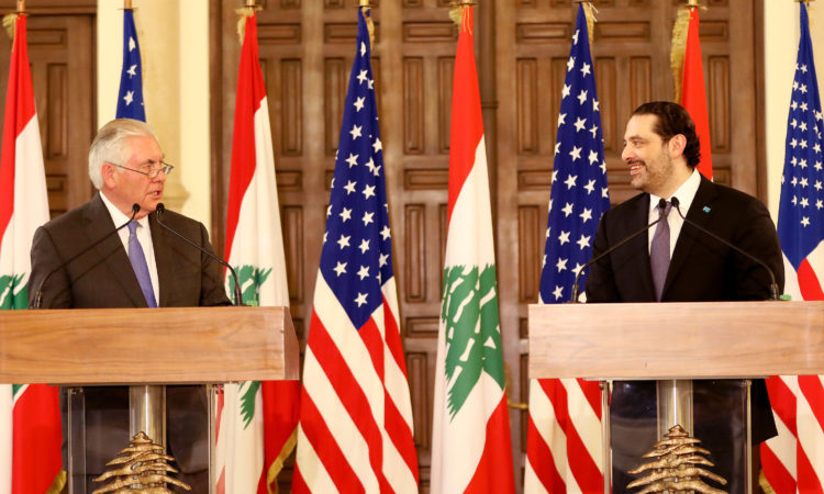 U.S and Lebanese flags and two men standing at podiums