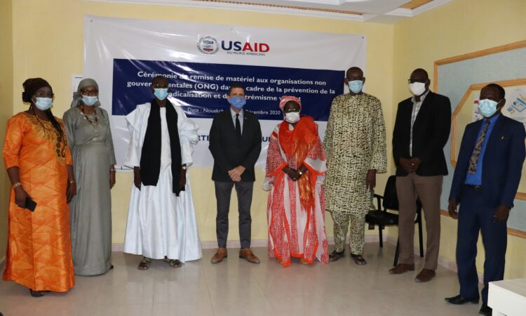A ceremony for the handing over of materials to two non-governmental organizations (NGOs)
