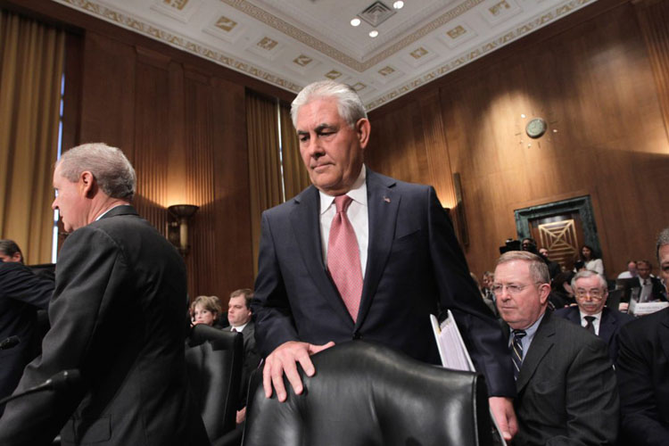 Rex Tillerson, shown here visiting Capitol Hill in 2011, is confirmed as the 69th secretary of state. (AP Images)