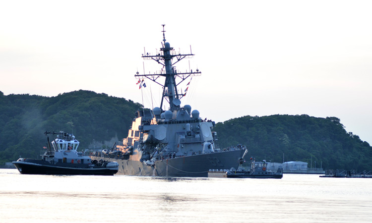The Arleigh Burke-class guided-missile destroyer USS Fitzgerald (DDG 62) returned under its own power to Yokosuka base on June 17 following a collision with a merchant vessel off the coast of Honshu. (U.S. Navy photo by Peter Burghart)
