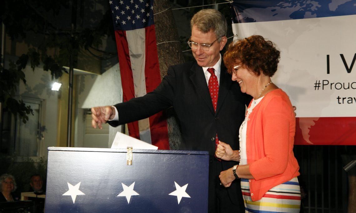 Ambassador and Mrs. Pyatt drop ballots in voting box (State Department Photo)