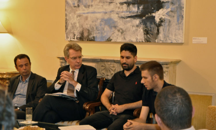 Ambassador Pyatt discusses with members of MITEF. (State Department Photo)