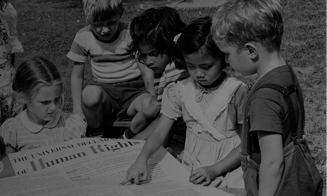 Kids reading newspaper on Human Rights Report (Screenshot from State.gov)