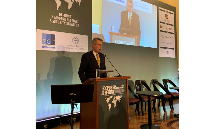 Man standing behind podium. (Embassy Image)