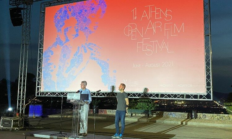 Two men standing on stage (Embassy Image)