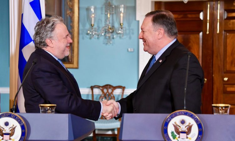 Secretary of State Michael R. Pompeo shakes hands with Greek Acting Minister of Foreign Affairs George Katrougalos following their remarks to reporters at the U.S. Department of State in Washington, D.C., on December 13, 2018. [State Department photo/ Public Domain]