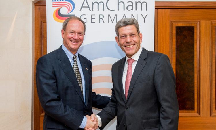 Photo of Bernhard Mattes welcoming Ambassador John B. Emerson