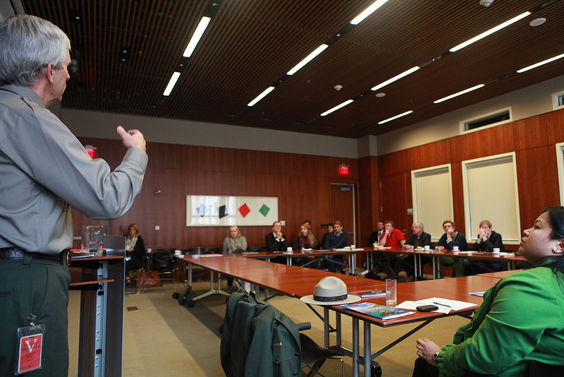 Photo of John Keck in discussion with participants