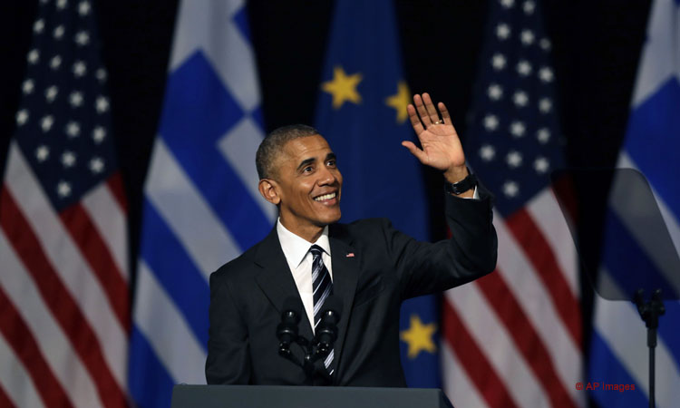 U.S. President Barack Obama waves to the crowd as he delivers a speech at the new opera of Athens on Wednesday, Nov. 16, 2016