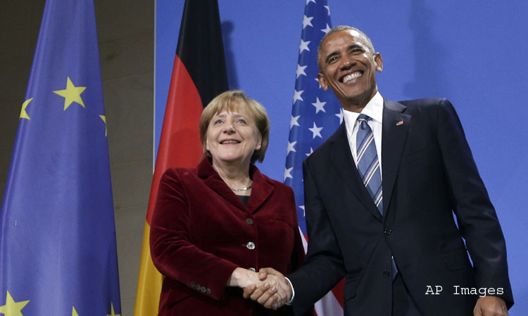 U.S. President Barack Obama, right, and German Chancellor Angela Merkel, left, shake hands after a press conference