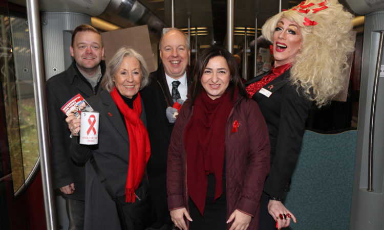 Chargé d'Affaires Kent Logsdon Rides the World AIDS Day Train in Berlin
