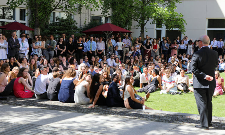young people sitting on lawn
