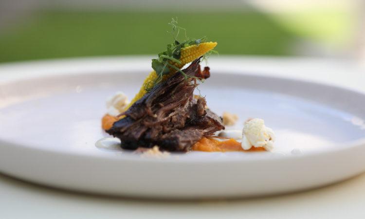 Slow-cooked U. S. beef short rib, sweet potato mash, corn and peanut crumble