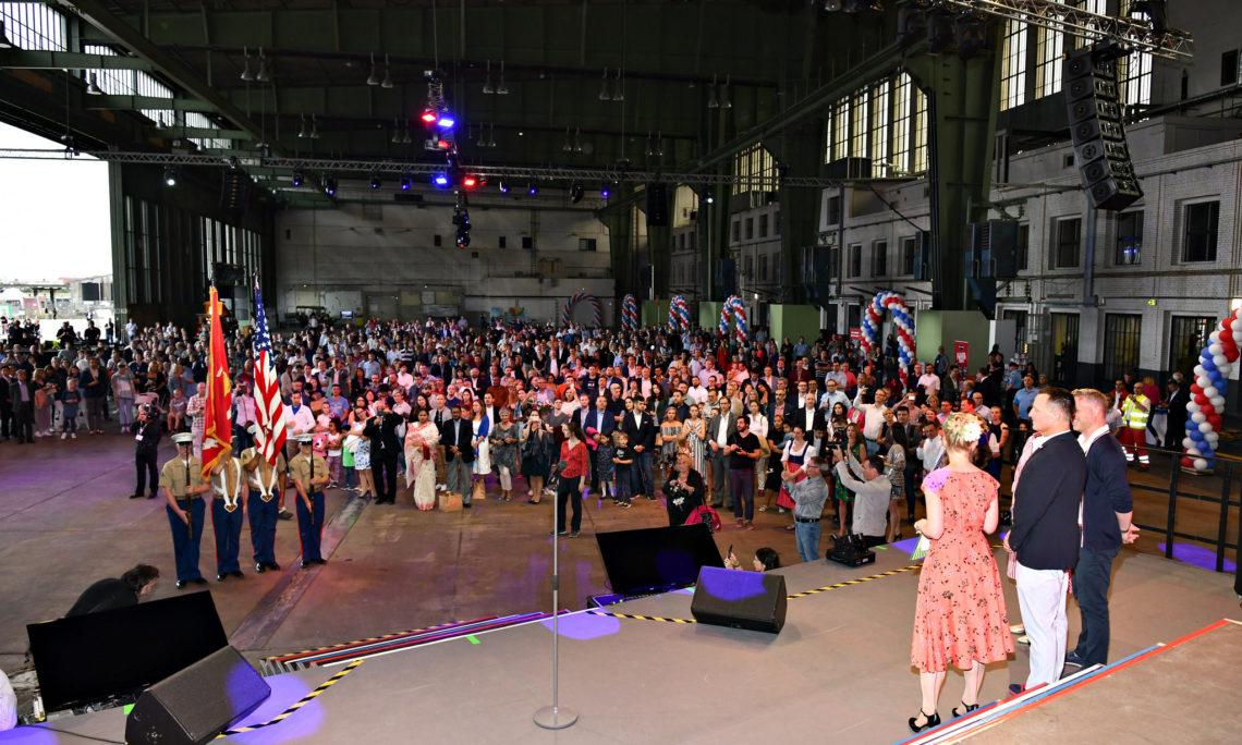 Crowd of people in hangar