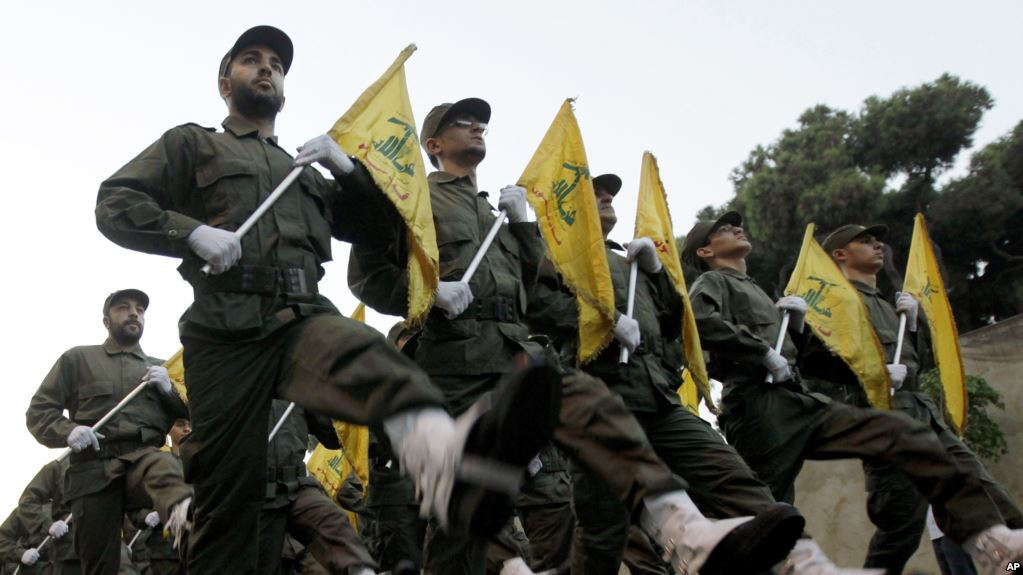 marching men in uniforms holding flags