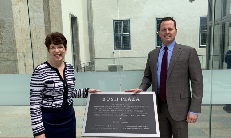 DCM Quinville and Ambassador Grenell with Bush Plaza plaque in middle