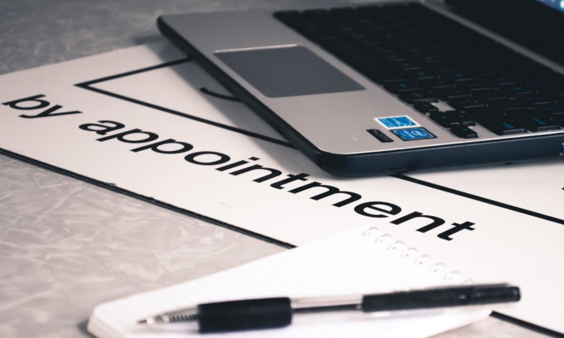 appointment_laptop_notepad_paper_pen