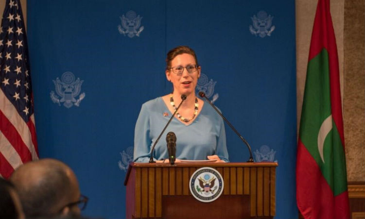 Lady speaking at podium. (State Dept.)