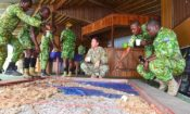 Team members from the U.S. Army Civil Affairs Team 8324,83rd Civil Affairs Battalion, receives an orientation on the terrain model provides guidance from the Eco-Guards in Loango National Park, Gabon