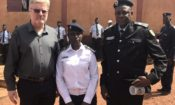 Ambassador Simon Henshaw with officers from the Central Police Station in Labe.