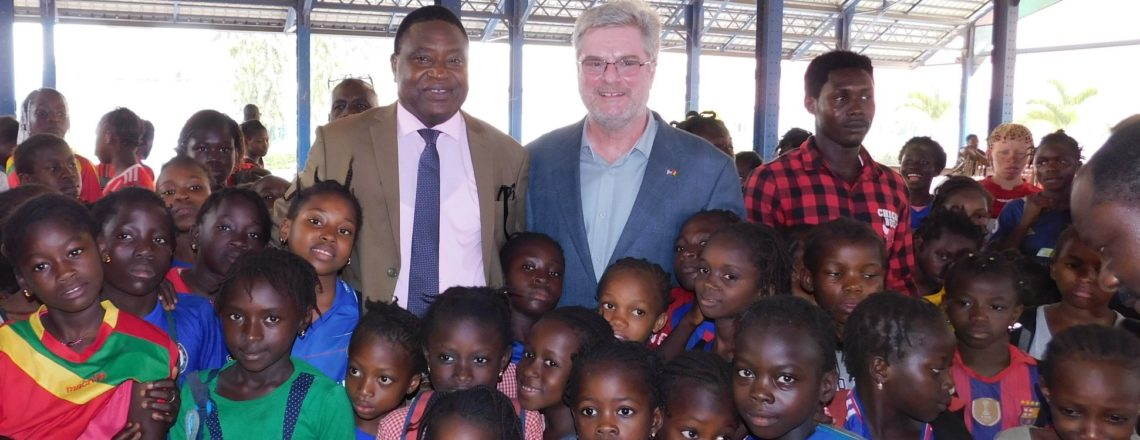 Ambassador Simon Henshaw Participates in Donation of TOMS Shoes to Students