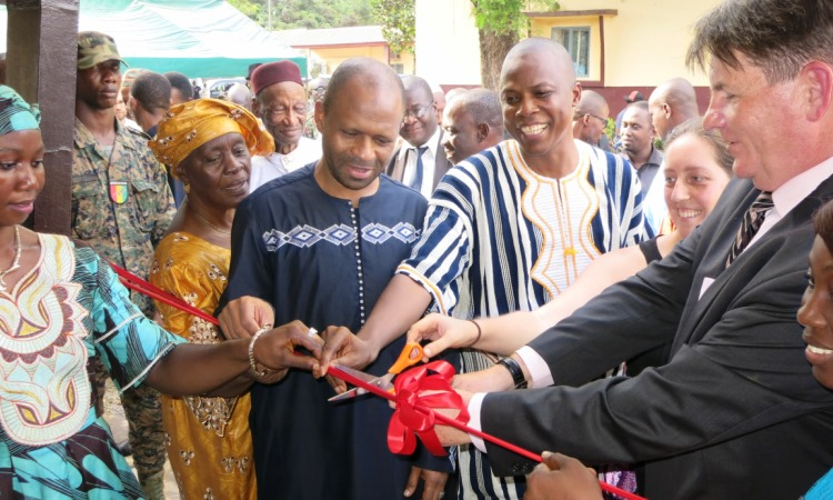 American Ambassador to Guinea cuts the ribbon.