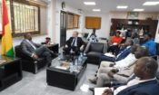 Ambassador Henshaw meeting with Minister of Communication and his staff.