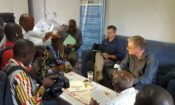 Ambassador Simon Henshaw addresses the press during his visit to the Kankan Regional Hospital.