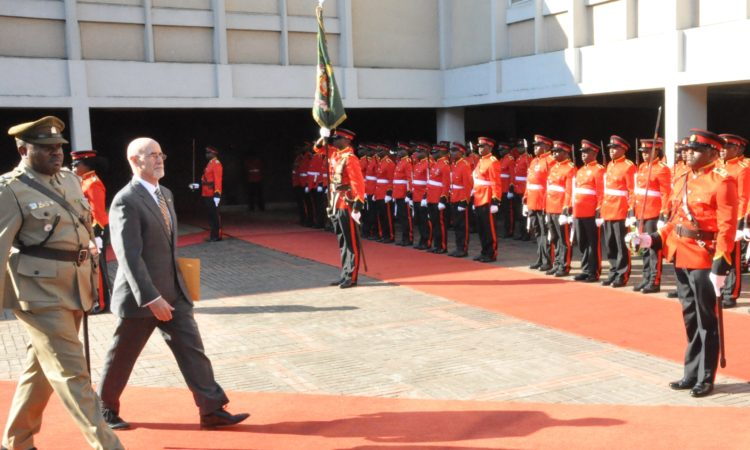 U.S. Ambassador Robert Scott inspecting guard of honor