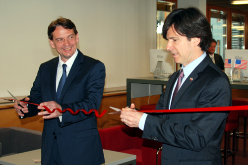 "Ambassador Andrew Schapiro and Director of the Moravian Land Library Tomáš Kubíček participate in a ribbon-cutting ceremony to open renovated American Space called ""InfoUSA""."