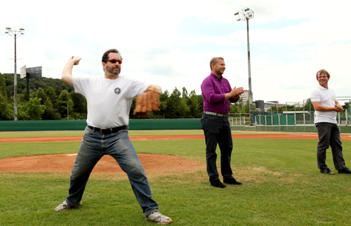 Chargé d'Affaires Steve Kaskett throws the first pitch at the start of Prague Baseball Week on June 24, 2014.
