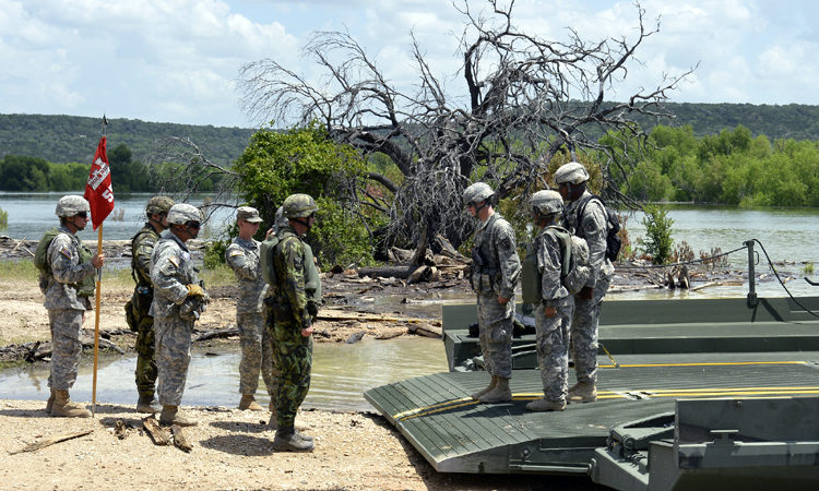 The Texas National Guard's 386th Engineer Battalion, U.S. Army's 20th Engineer Battalion, and the Czech Republic 15th Engineer prepare to inspect the floating bridge before a transportation mission June 21, 2016, at Fort Hood, Texas.