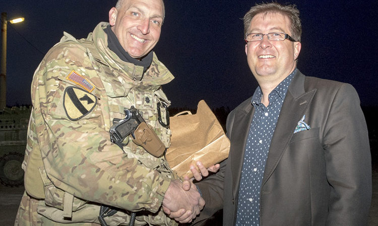 Hynek Homolka, deputy mayor of Brandýs nad Labem-Stará Boleslav, Czech Republic, greets Lt. Col. Steven Gventer, commander of Battle Group Poland, March 25 to welcome the U.S. Army and other members of the unique NATO formation as they stop in the Czech Republic on their way to Poland.